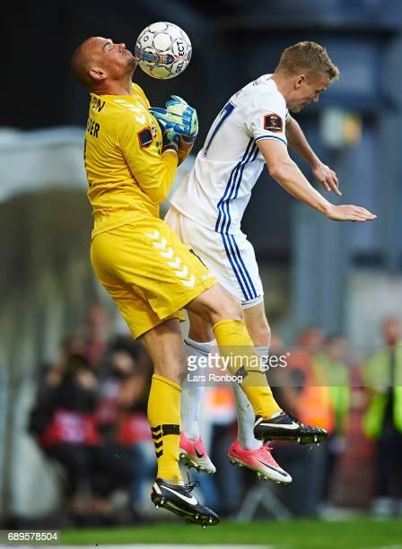 Goalkeeper Marin Skender of Sonderjyske and Kasper Kusk of FC Copenhagen compete for the ball during the Danish Alka Superliga match between FC...