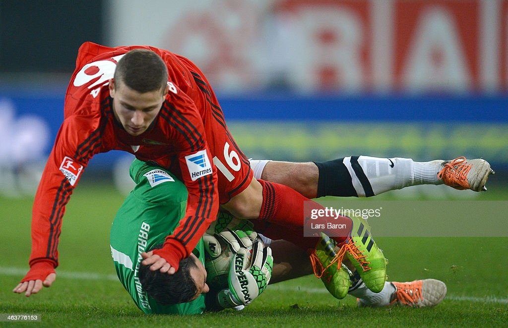 Goalkeeper Marjan Petkovic of Braunschweig is challenged by Maximilian Wagener of Leverkusen during the Stadtwerke Duesseldorf Wintercup 2014 final...