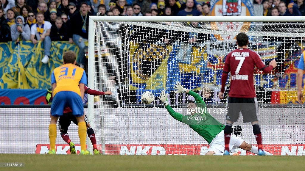 Goalkeeper Marjan Petkovic of Braunschweig parries the penalty of Hiroshi Kiyotake of Nuernberg during the Bundesliga match between 1 FC Nuernberg...