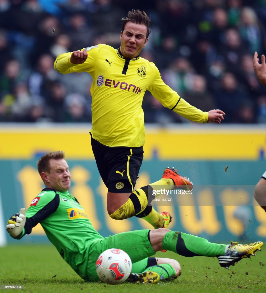 Goalkeeper Mark Andre Ter Stegen of Moenchengladbach challenges <a gi-track='captionPersonalityLinkClicked' href=/galleries/search?phrase=Mario+Goetze&family=editorial&specificpeople=4251202 ng-click='$event.stopPropagation()'>Mario Goetze</a> of Dortmund during the Bundesliga match between VfL Borussia Moenchengladbach and Borussia Dortmund at Borussia Park Stadium on February 24, 2013 in Moenchengladbach, Germany.