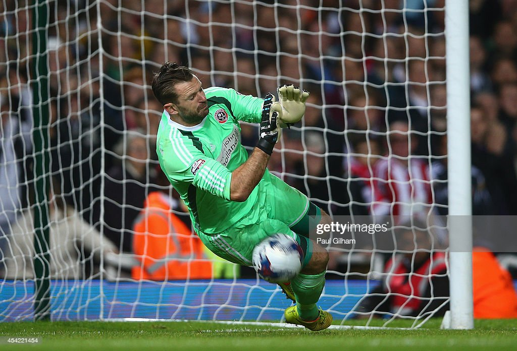 Goalkeeper Mark Howard of Sheffield United saves the penalty in a penalty shoot out from Enner Valencia of West Ham United resulting in Sheffield United winning the Capital One Cup between West Ham United and Sheffield United at the Boleyn Ground on August 26, 2014 in London, England.