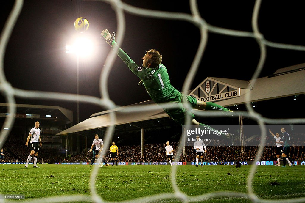 Goalkeeper Mark Schwartzer of Fulham dives in vain as Stephane Sessegnon (obscured) of Sunderland scores his team's third goal during the Barclays Premier League match between Fulham FC and Sunderland AFC at Craven Cottage on November 18, 2012 in London, England.