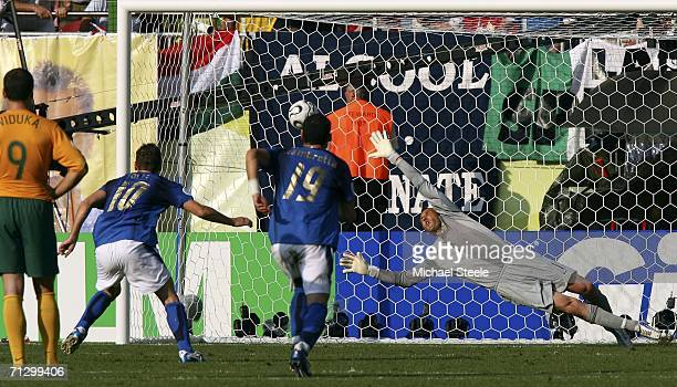 Goalkeeper Mark Schwarzer of Australia dives in vain as the match winning penalty from Francesco Totti of Italy flies into the net during the FIFA...
