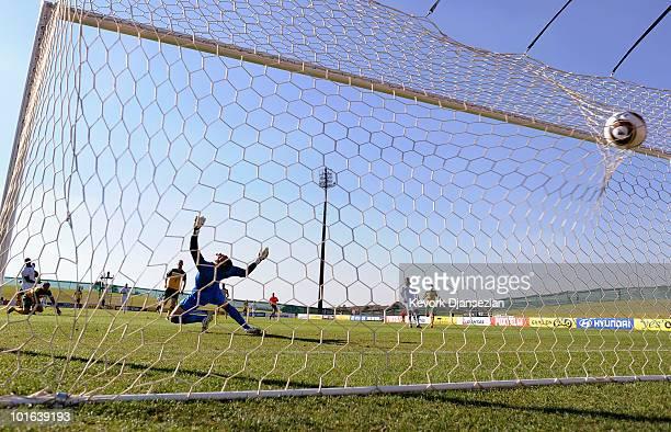 Goalkeeper Mark Schwarzer of Australia fails to stop a goal scored by Edson Buddle of USA during first half of the 2010 FIFA World Cup PreTournament...