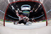 Goalkeeper Martin Brodeur of Canada makes a save during the ice hockey men's preliminary game between Switzerland and Canada on day 7 of the 2010...