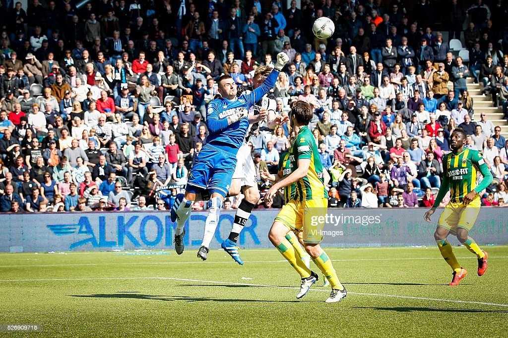goalkeeper Martin Hansen of ADO Den Haag, Wout Weghorst of Heracles Almelo, Mike Havenaar of ADO Den Haag, Wilfried Kanon of ADO Den Haag during the Dutch Eredivisie match between Heracles Almelo and ADO Den Haag at Polman stadium on May 01, 2016 in Almelo, The Netherlands