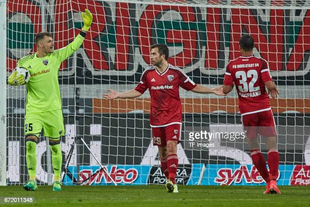 Goalkeeper Martin Hansen of Ingolstadt Markus Suttner of Ingolstadt and Marcel Tisserand of Ingolstadt gestures during the Bundesliga match between...
