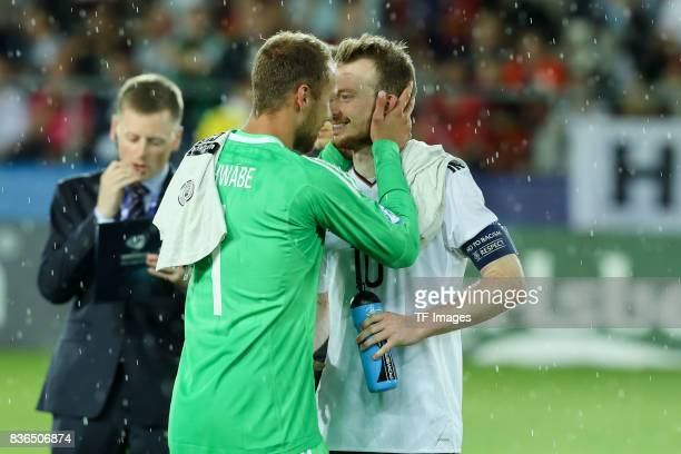 Goalkeeper Marvin Schwaebe of Germany shakes hands with Maximilian Arnold of Germany during the UEFA U21 Final match between Germany and Spain at...