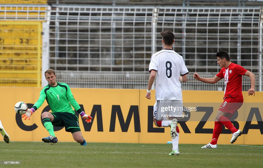 Goalkeeper Marvin Schwaebe of Germany without a chance Mariusz Stepinski of Poland scores the opening goal during the International Friendly match...