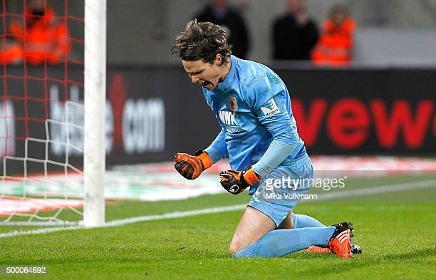 Goalkeeper Marwin Hitz of Augsburg holds a penalty and celebrates during the Bundesliga match between 1 FC Koeln and FC Augsburg at...