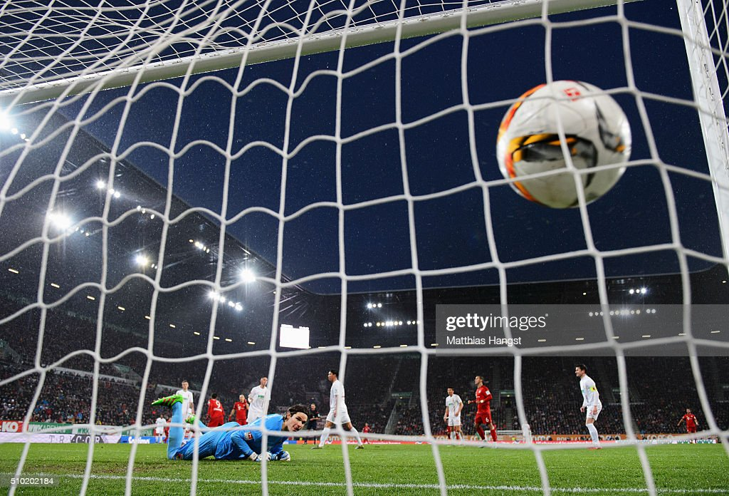 Goalkeeper <a gi-track='captionPersonalityLinkClicked' href=/galleries/search?phrase=Marwin+Hitz&family=editorial&specificpeople=5697209 ng-click='$event.stopPropagation()'>Marwin Hitz</a> of Augsburg looks on as <a gi-track='captionPersonalityLinkClicked' href=/galleries/search?phrase=Robert+Lewandowski&family=editorial&specificpeople=5532633 ng-click='$event.stopPropagation()'>Robert Lewandowski</a> of Bayern Munich (9) scores their first goal during the Bundesliga match between FC Augsburg and FC Bayern Muenchen at SGL Arena on February 14, 2016 in Augsburg, Germany.