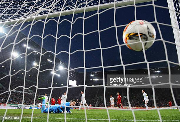 Goalkeeper Marwin Hitz of Augsburg looks on as Robert Lewandowski of Bayern Munich scores their first goal during the Bundesliga match between FC...