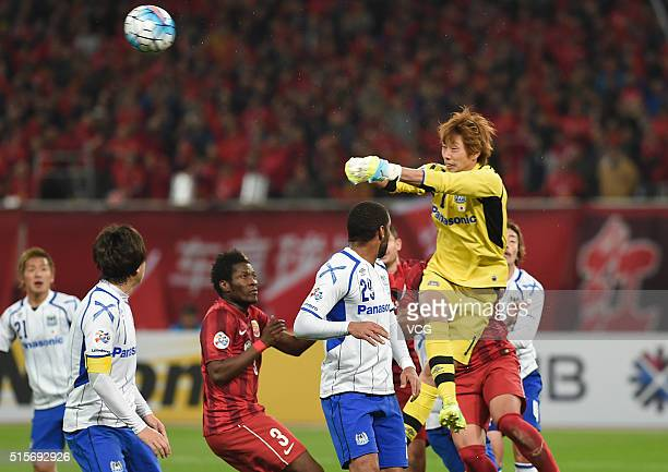 Goalkeeper Masaaki Higashiguchi of Gamba Osaka saves the ball during the AFC Champions League Group G match between Shanghai SIPG and Gamba Osaka at...