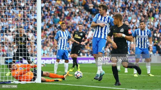 Goalkeeper Mathew Ryan of Brighton and Hove Albion dives as Jonjo Shelvey of Newcastle United hits the post from a corner during the Premier League...