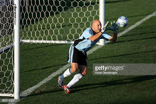 Goalkeeper Matt Reis of the New England Revolution makes a save in the second half during their SuperLiga match against CD Chivas USA at Titan...