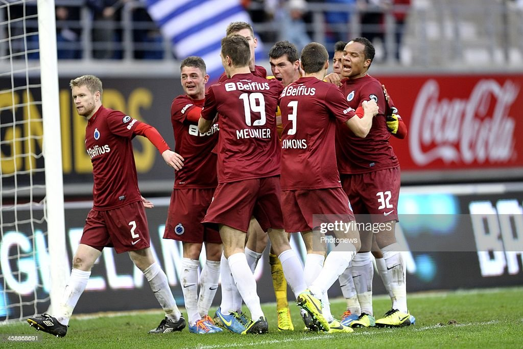 Goalkeeper <a gi-track='captionPersonalityLinkClicked' href=/galleries/search?phrase=Matthew+Ryan+-+Soccer+Player&family=editorial&specificpeople=7314826 ng-click='$event.stopPropagation()'>Matthew Ryan</a> of Club Brugge is celebrating stopping a penalty from Nicklas Pedersen of KAA Gent with teammates during the Jupiler League match between KAA Gent and Club Brugge on December 22, 2013 at the Ghelamco arena in Gent, Belgium.