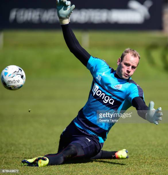 Goalkeeper Matz Sels dives and saves the ball during the Newcastle United Training Session at The Newcastle United Training Centre on May 4 2017 in...