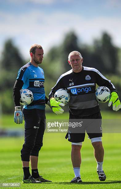 Goalkeeper Matz Sels holds on to the ball whilst talking to Newcastle United's Goalkeeping Coach Simon Smith during the Newcastle United Training...