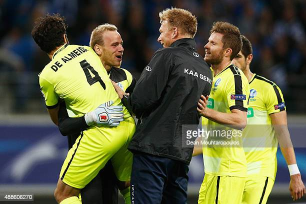 Goalkeeper Matz Sels of Gent is congratulated by team mates after the final whistle during the UEFA Champions League Group H match between KAA Gent...