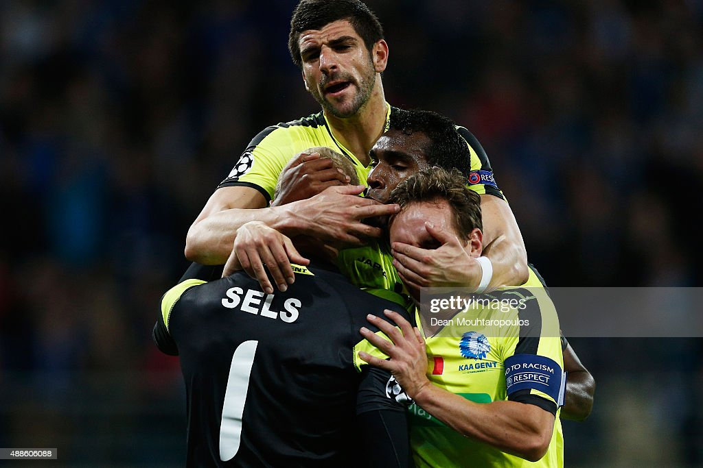 Goalkeeper Matz Sels of Gent is congratulated by team mates Sven Kums Renato Cardoso Neto and Stefan Mitrovic after he saves a penalty in the final...