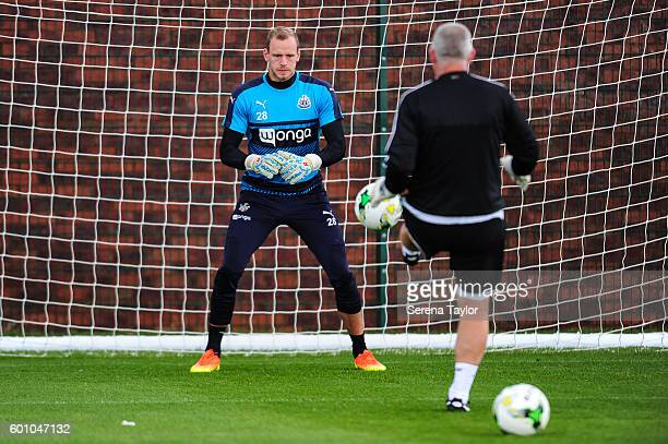 Goalkeeper Matz Sels warms up with Goalkeeping coach Simon Smith during the Newcastle United training session at The Newcastle United Training Centre...