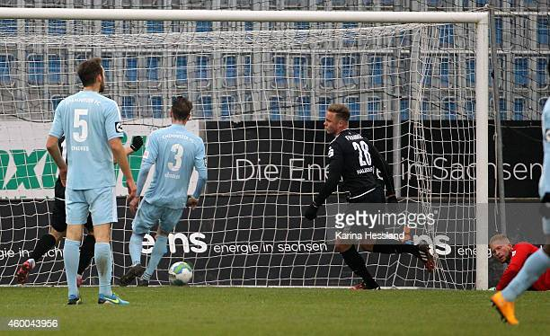 Goalkeeper Max Reule of Chemnitz without a chance Marcel Franke of Halle scores the opening goal during the 3Liga match between Chemnitzer FC and...
