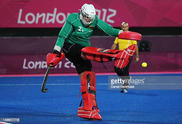 Goalkeeper Max Winhold of Germany clears the ball during the Men' preliminary Hockey match between South Korea and Germany on Day 5 of the London...