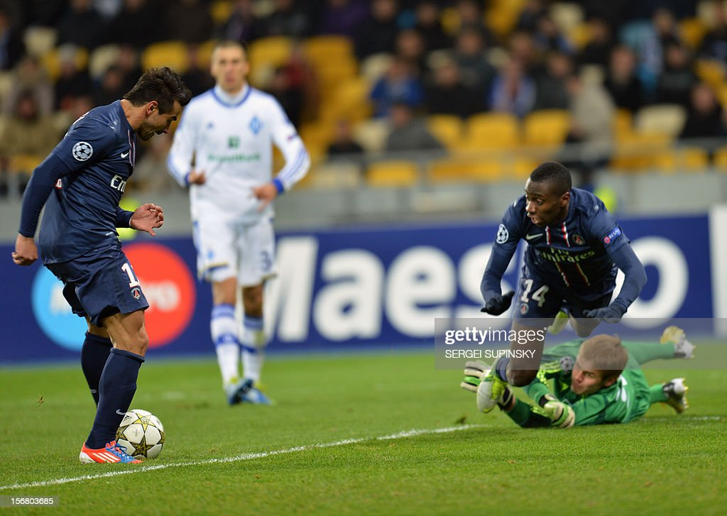 Goalkeeper Maxym Koval of Dynamo Kiev (down,R) fighs for the ball with Marco Verratti as Ezequiel Lavezzi of Paris Saint-Germain FC shoots during the UEFA Champions League, Group A, football match in Kiev on November 21, 2012.