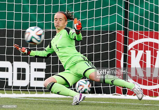 Goalkeeper Meike Kaemper of Germany fails to save a penalty kick by Zhu Beiyan of China PR at Commonwealth Stadium on August 8 2014 in Edmonton Canada