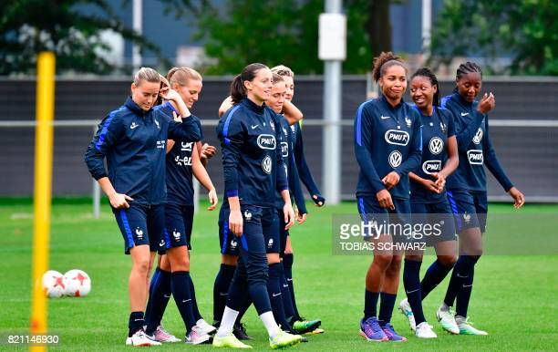 Goalkeeper Meline Gerard goalkeeper Laetitia Philippe defender Laura Georges and midfielder Grace Geyoro attend a training session of France's women...