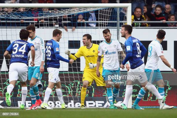 Goalkeeper Michael Esser of Darmstadt celebratzes after saving a penalty from Guido Burgstaller of Schalke during the Bundesliga match between SV...