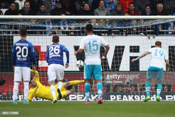 Goalkeeper Michael Esser of Darmstadt saves a penalty from Guido Burgstaller of Schalke during the Bundesliga match between SV Darmstadt 98 and FC...