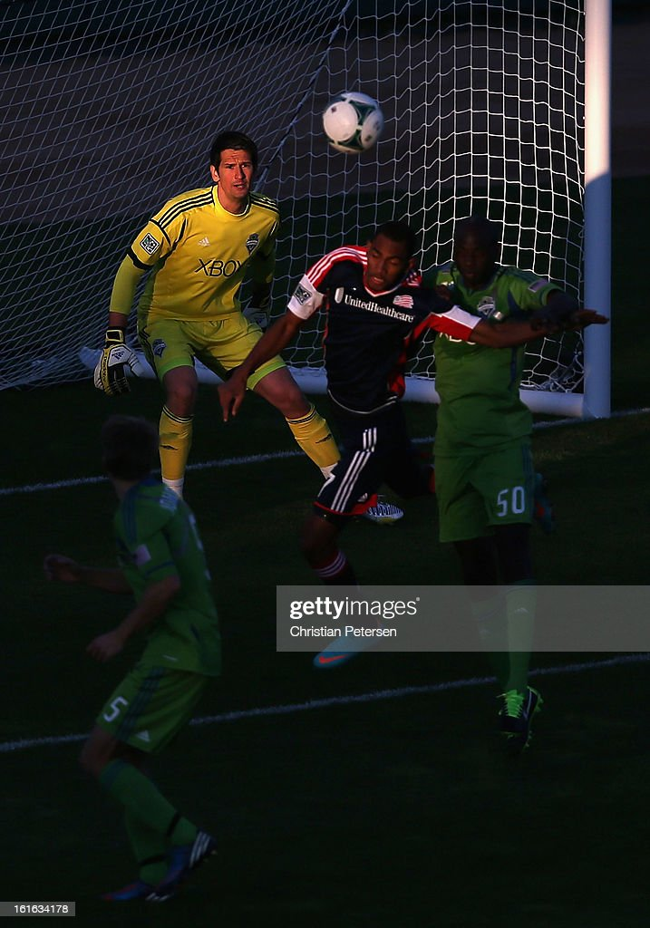 Goalkeeper Michael Gspurning #1 of the Seattle Sounders follows the play as Juan Toja #7 of the New England Revolution goes up for a header during the first half of the FC Tucson Desert Diamond Cup at Kino Sports Complex on February 13, 2013 in Tucson, Arizona.