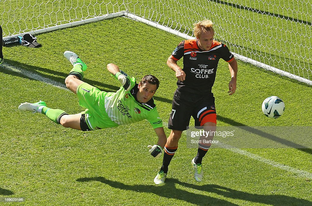 Goalkeeper Michael Theo of the Roar makes a save during the round 15 A-League match between the Melbourne Heart and the Brisbane Roar at AAMI Park on January 6, 2013 in Melbourne, Australia.