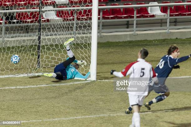 Goalkeeper Mike Randall of RutgersCamden can't stop a shot on goal from Messiah's Brian Ramirez during the Division III Men's Soccer Championship...