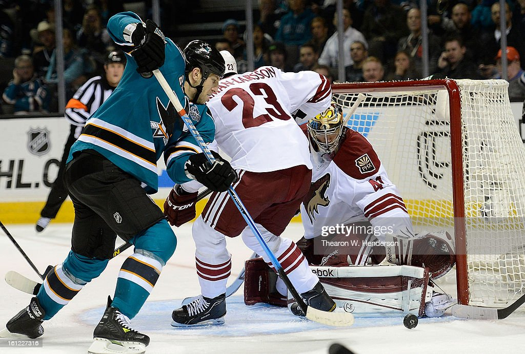 Goalkeeper Mike Smith #41 of the Phoenix Coyotes blocks a shot knocking the rebound away from Ryane Clowe #29 of the San Jose Sharks in the second period at HP Pavilion on February 9, 2013 in San Jose, California.