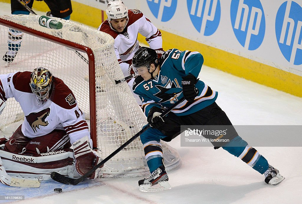 Goalkeeper Mike Smith #41 of the Phoenix Coyotes blocks the wrap around shot of Tommy Wingels #57 of the San Jose Sharks in the third period at HP Pavilion on February 9, 2013 in San Jose, California. The Coyotes won the game 1-0 in an overtime shoot-out.