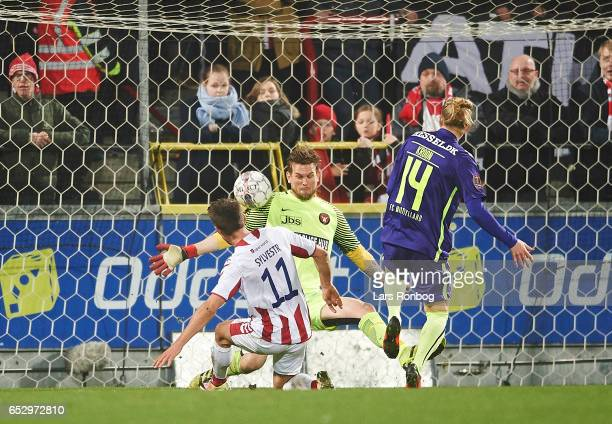 Goalkeeper Mikkel Andersen of FC Midtjylland saves the ball from Jakub Sylvestr of AaB Aalborg during the Danish Alka Superliga match between AaB...