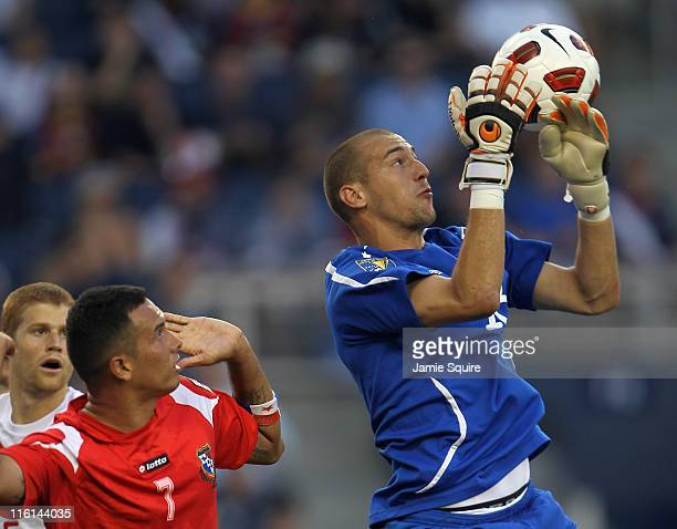 Goalkeeper Milan Borjan of Canada makes a save over Blas Perez of Panama during the GoldCup game on June 14 2011 at LiveStrong Sporting Park in...