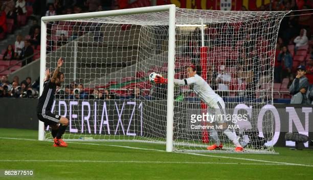 Goalkeeper Mile Svilar of Benfica tries to keep the ball from crossing the line but a goal is given making the score 01 during the UEFA Champions...