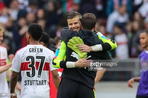 Goalkeeper Mitchell Langerak of Stuttgart Head coach Hannes Wolf of Stuttgart celebrate their win during the Second Bundesliga match between VfB...