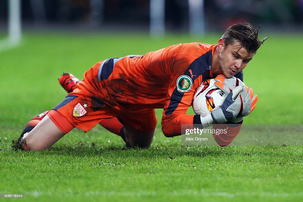 Goalkeeper <a gi-track='captionPersonalityLinkClicked' href=/galleries/search?phrase=Mitchell+Langerak&family=editorial&specificpeople=4320478 ng-click='$event.stopPropagation()'>Mitchell Langerak</a> of Stuttgart makes a save during the DFB Cup Quarter Final match between VfB Stuttgart and Borussia Dortmund at Mercedes-Benz Arena on February 9, 2016 in Stuttgart, Germany.