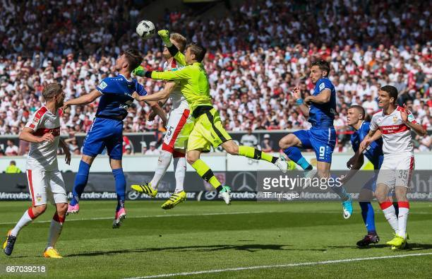 Goalkeeper Mitchell Langerak of Stuttgart Timo Baumgartl of Stuttgart and Dennis Kempe of Karlsruher SC battle for the ball during the Second...