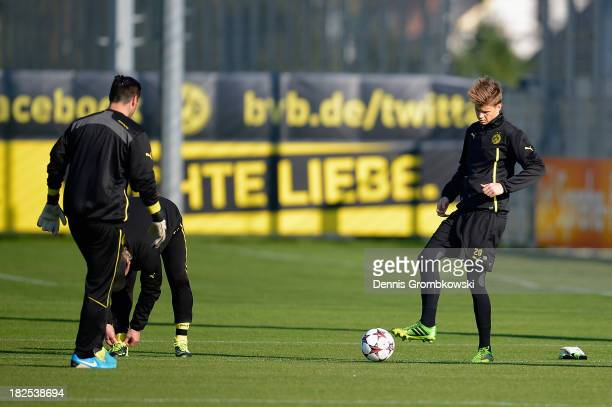 Goalkeeper Mitchell Langerak warms up during a training session ahead of their Champions League match against Olympique Marseille on September 30...