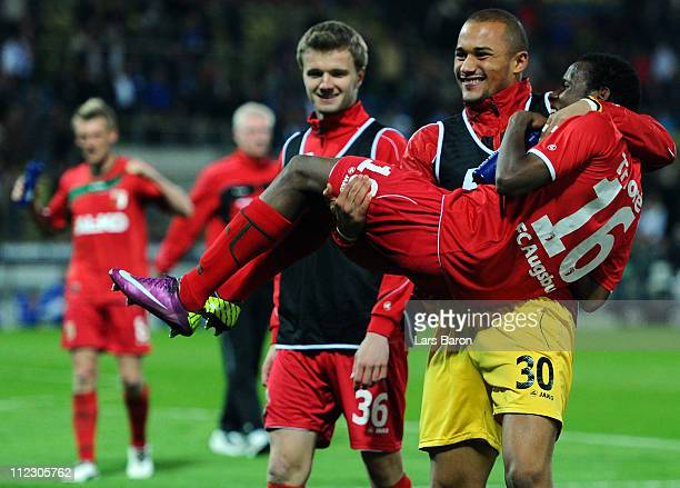 Goalkeeper Mohamed Amsif of Augsburg celebrates with team mate Ibrahima Traore after winning the Second Bundesliga match between Karlsruher SC and FC...