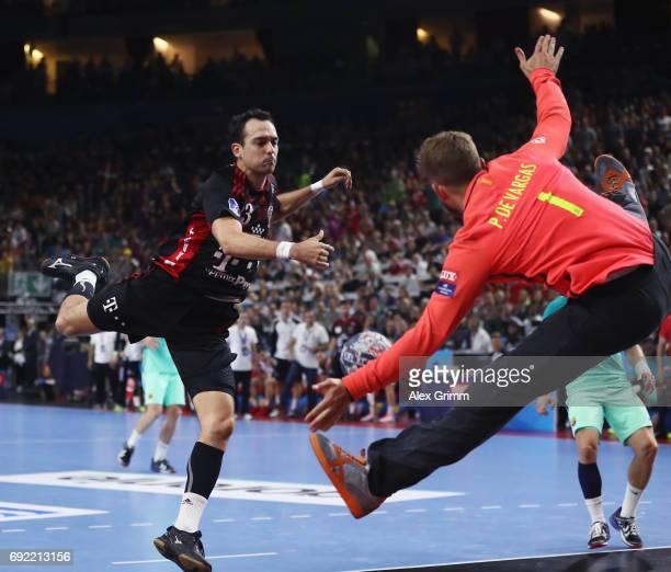 Goalkeeper Moreno Perez de Vargas of Barcelona makes a save against Cristian Ugalde Garcia of Veszprem during the VELUX EHF FINAL4 3rd place match...