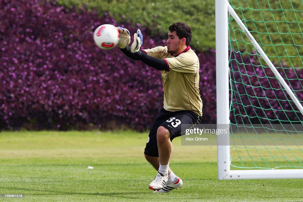 Goalkeeper Muhannad Naim Hussein of Al Sadd makes a save during a Schalke 04 training session at the ASPIRE Academy for Sports Excellence on January 7, 2013 in Doha, Qatar.