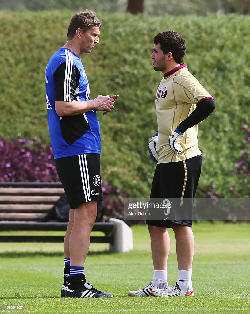 Goalkeeper Muhannad Naim Hussein of Al Sadd talks to goalkeeper coach Holger Gehrke during a Schalke 04 training session at the ASPIRE Academy for Sports Excellence on January 7, 2013 in Doha, Qatar.