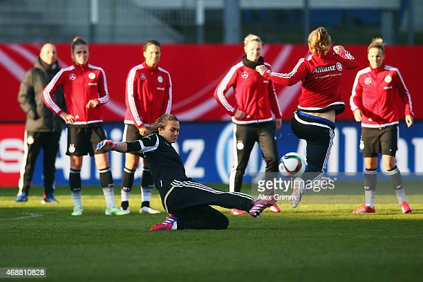 Goalkeeper Nadine Angerer is challenged by Tabea Kemme during a Germany trining session ahead of their friendly match against Brazil at Sportpark...