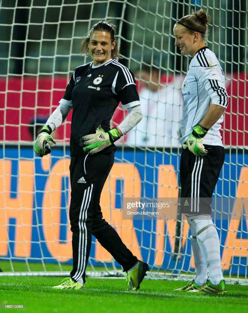 Goalkeeper <a gi-track='captionPersonalityLinkClicked' href=/galleries/search?phrase=Nadine+Angerer&family=editorial&specificpeople=2149437 ng-click='$event.stopPropagation()'>Nadine Angerer</a> of Germany jokes with goalkeeper <a gi-track='captionPersonalityLinkClicked' href=/galleries/search?phrase=Almuth+Schult&family=editorial&specificpeople=2133917 ng-click='$event.stopPropagation()'>Almuth Schult</a> of Germany (R) during a Germany training session at Volksbank Stadion on October 29, 2013 in Frankfurt am Main, Germany.
